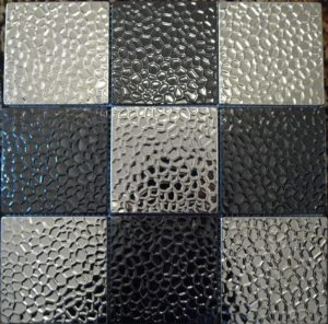 textured<a target='_blank' href='https://www.tilesandpavers.com.au/metal-tiles/stainless-steel-tiles'> stainless steel</a> tile - metal hammered look