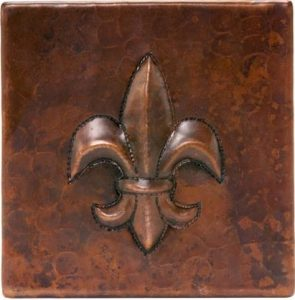 Metal tile with raised copper Fleur De Lis