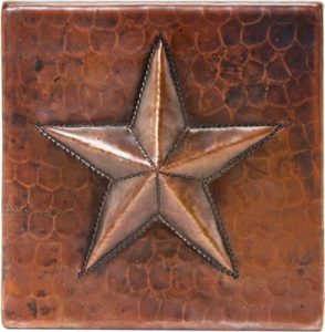A metal tile made from copper with a lifter star symbol
