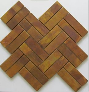 This metal herringbone tile is great for kitchen and bathroom splashbacks. The tile is made from copper.