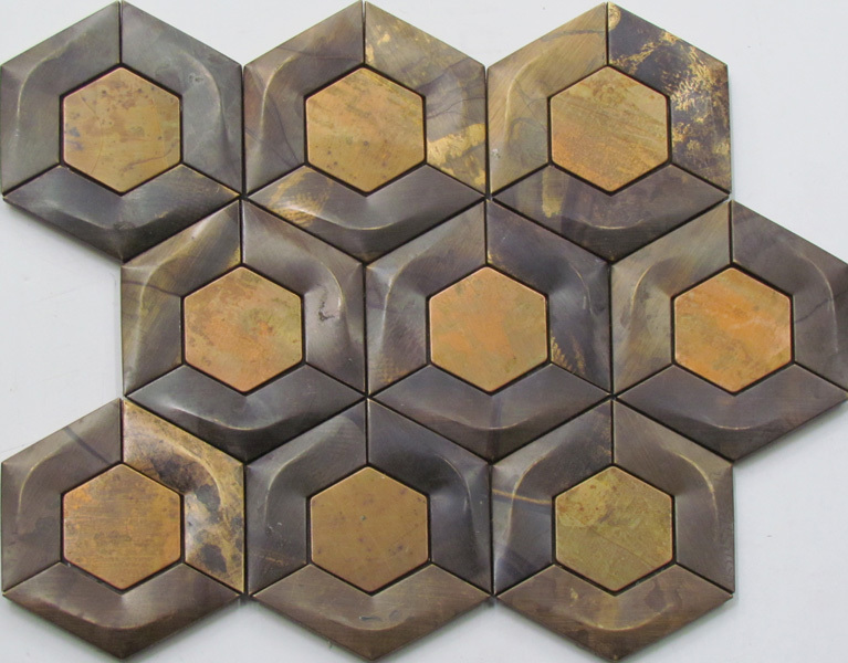A beautiful hexagonal wall tile. This is a metal mosaic tile made from copper.