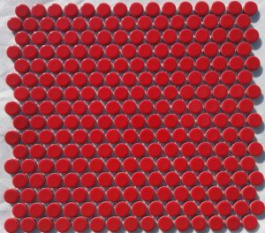 A red coloured round, penny mosaic tile.