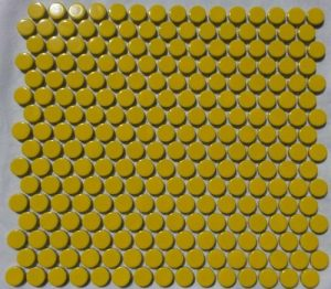 A yellow coloured round, penny mosaic tile.