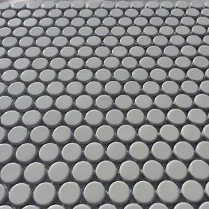 A matte white round penny porcelain mosaic tile