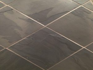 Charcoal coloured clate floor and wall tile
